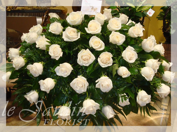 White roses funeral sympathy flower arrangement le jardin florist premium white roses mightylinksfo Image collections