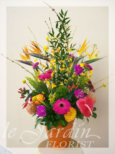 Celebration flower arrangement le jardin florist for Arrangement jardin