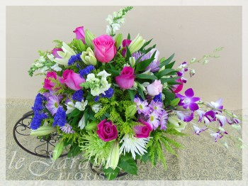Blooming Three-Wheeler - a Le Jardin Florist Signature Floral Arrangement